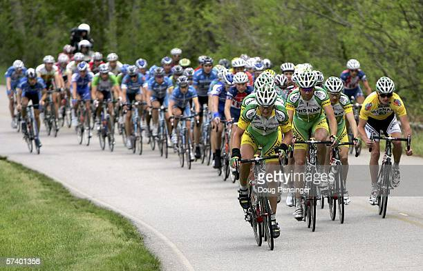 The Phonak Hearing Systems team drives the peloton as the successfully defended the yellow leaders jersey for Floyd Landis right of the USA during...