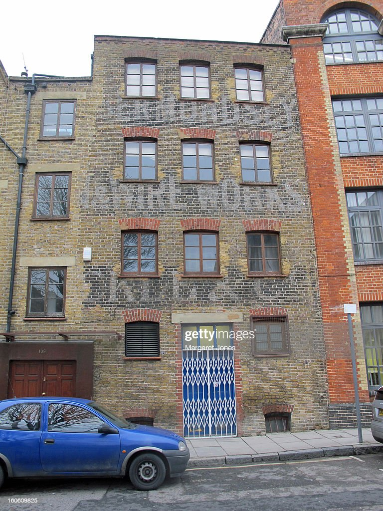 CONTENT] The photo shows a faded painted advert on the bricks of a former wire works factory. Tanner Street.