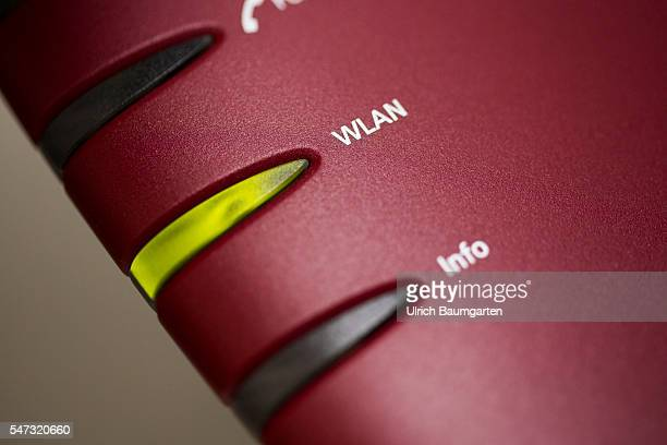 The photo shows the WLAN icon on a wireless router