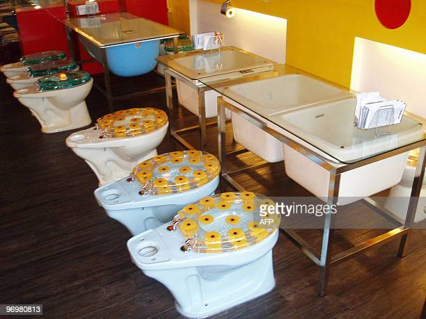 The photo taken 10 May 2005 shows the interior decor of Marton Theme Restaurant which is decorated with colorful bathtubs faucets mirrors and shower...