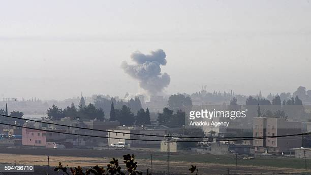 The photo taken from Karkamis district of the Turkey's Gaziantep province shows smoke rising as the Turkish fighter jets bomb Daesh targets in...