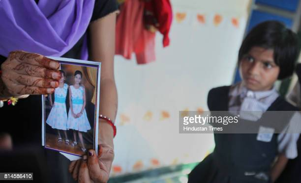 The photograph of Jamuna Dholia the 10yearold school girl run over by a pickup truck at Nehru Nagar in Kurla East as her classmate watches Dholi and...