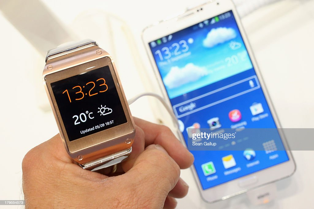 The photographer holds the new Galaxy Gear smartwatch next to the new Galaxy Note 3 smartphone at the Samsung stand at the IFA 2013 consumer electronics trade fair on September 5, 2013 in Berlin, Germany. The 2013 IFA will be open to the public from September 6-11.