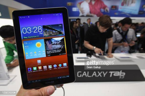The photographer holds up a Samsung Galaxy Tab 77 tablet at the Samsung hall at the IFA 2011 consumer electonics and appliances fair the day before...