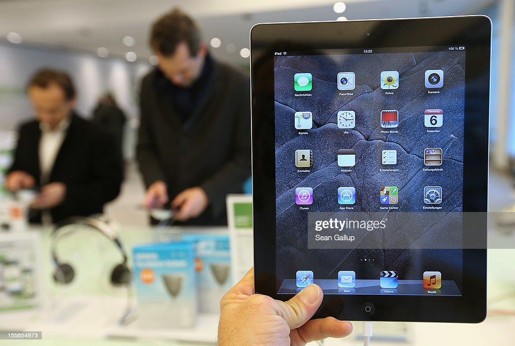 The photographer holds up the 4th generation Apple iPad at a display table at a Gravis Apple retailer on November 6, 2012 in Berlin, Germany. Apple recently released the Apple iPad Mini to compete with the growing number of small, tablet computers and the company is hoping for a strong Christmas season.