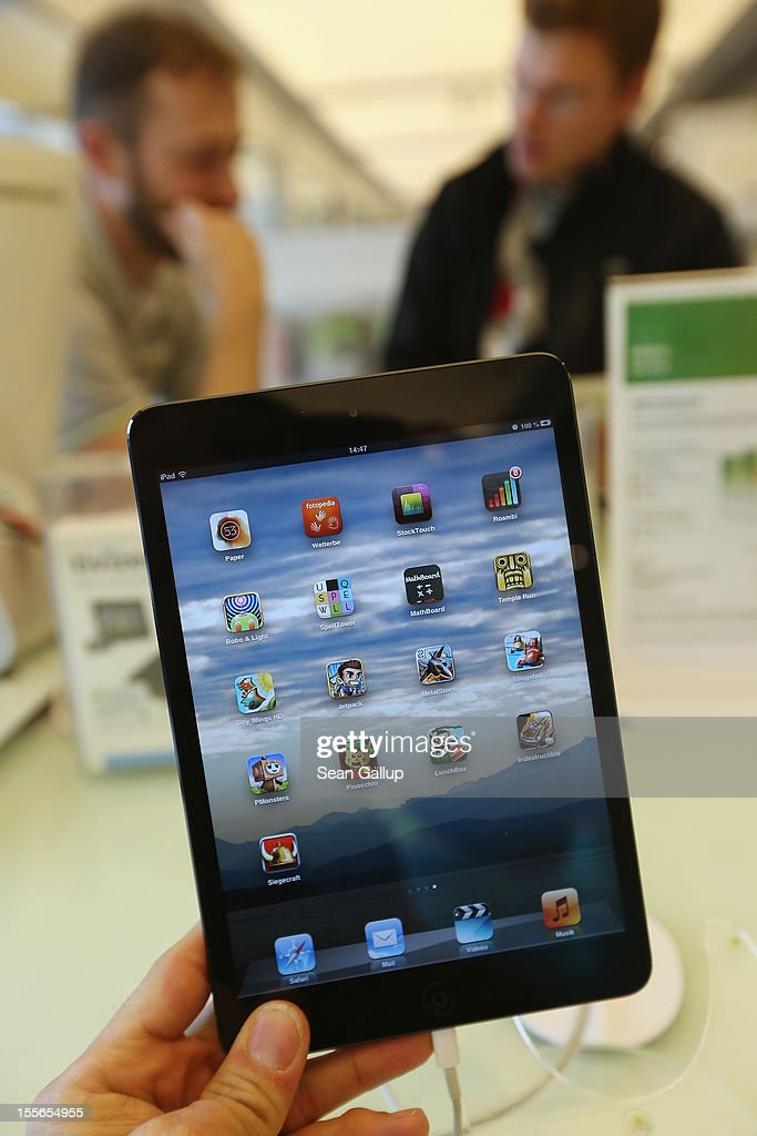 The photographer holds up the new Apple iPad mini at a display table at a Gravis Apple retailer on November 6, 2012 in Berlin, Germany. Apple recently released the Mini to compete with the growing number of small, tablet computers and the company is hoping for a strong Christmas season.
