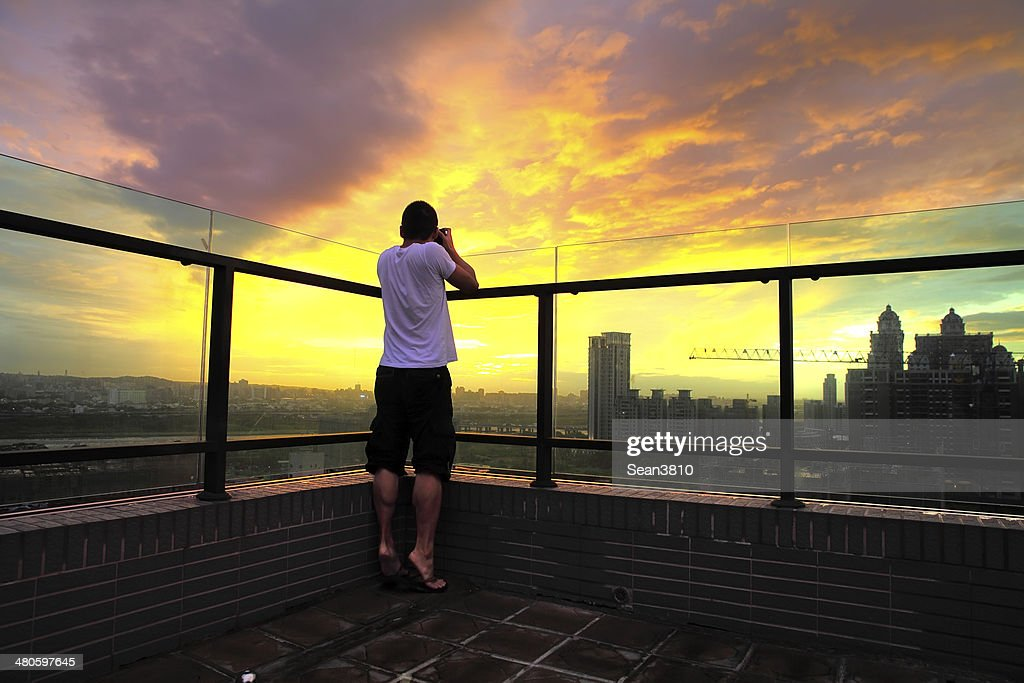 The photographer takes a good shot during sunset : Stock Photo