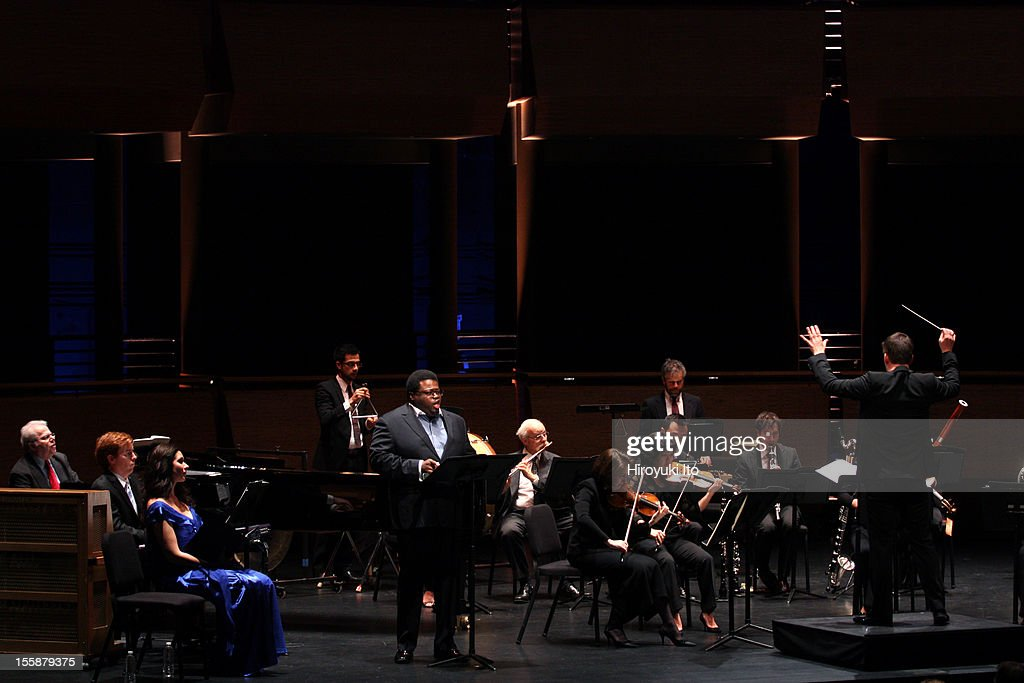 The pianist Emanuel Ax and musicians from the New York Philharmonic performing in 'Song of the Earth' as part of Lincoln Center's White Light Festival at the Rose Theater on Sunday afternoon, November 4, 2012.This image:Matthias Pintscher conducting Mahler's 'Das Lied von der Erde' with the tenor Russell Thomas and the pianist Emanuel Ax.