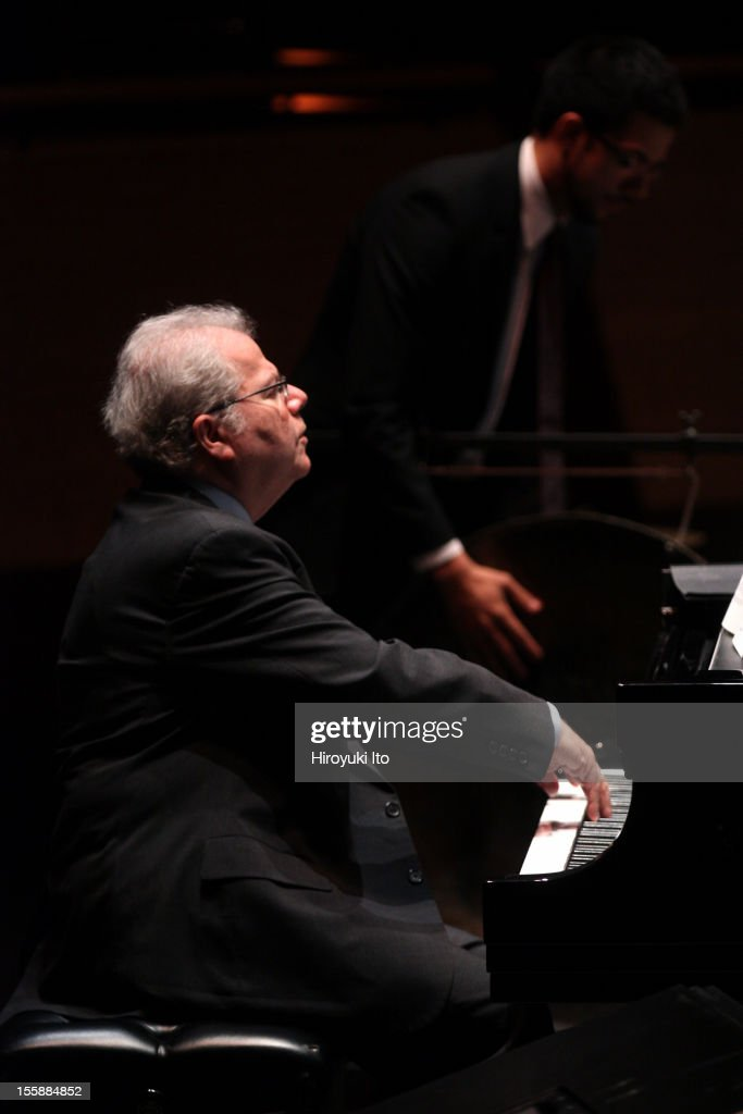 The pianist Emanuel Ax and musicians from the New York Philharmonic performing in 'Song of the Earth' as part of Lincoln Center's White Light Festival at the Rose Theater on Sunday afternoon, November 4, 2012.This image:Emanuel Ax, left, and Kyle Zerna on percussion performing Mahler's 'Das Lied von der Erde.'