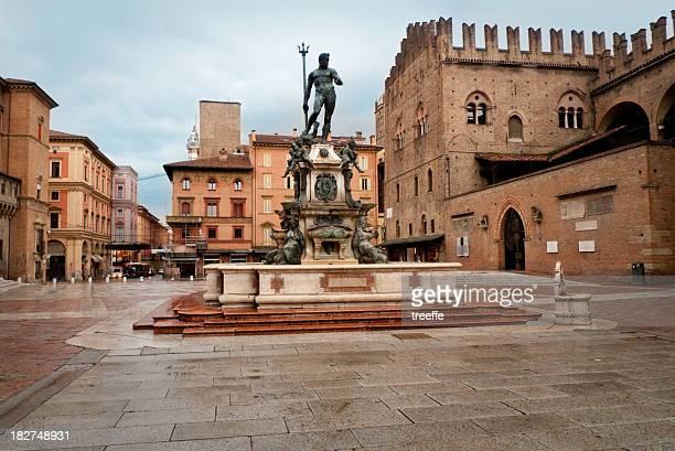 The Piazza Maggiore in Bologna under a blue sky