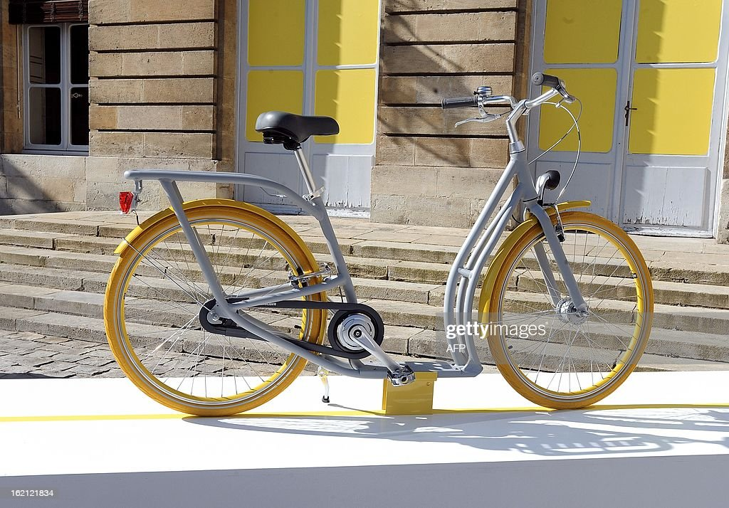 'The Pibal', the city of Bordeaux's new hybrid urban bicycle designed by Philippe Starck, is displayed on February 19, 2013 during its presentation in the Town Hall. The bikes, manufactured by Peugeot, should be available in September 2013. AFP PHOTO / JEAN PIERRE MULLER