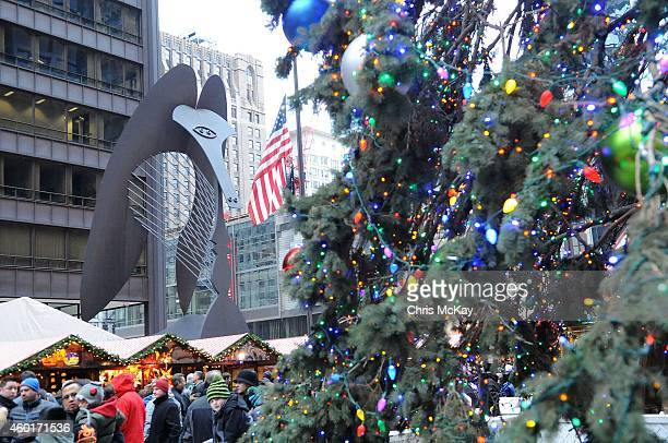 The Picasso sculpture in the background as shoppers enjoy the Christkindlmarket in Daley Plaza on December 08 2014 in Chicago Illinois