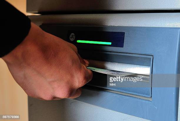 The picture featuring people using atm services to withdraw cash on January 29 2013 in New Delhi India