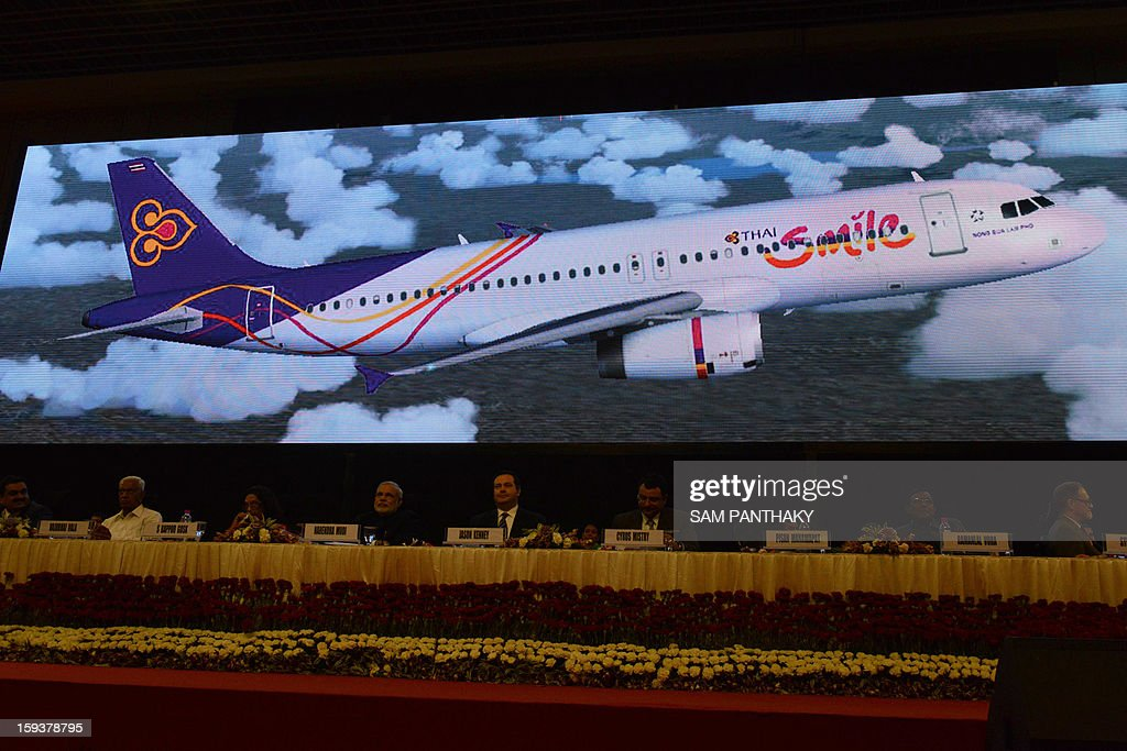 The picture of a Thai Airways International plane is displayed on a screen, as participants attend the Velidictory function of the Vibrant Gujarat 2013 6th Global Summit at Mahatma Mandir in Gandhinagar, some 30 kms from Ahmedabad on January 12, 2013. The summit was inaugurated by Gujarat Chief Minister, Narendra Modi on January 11 and the two day summit is attended by a wide range of national and international corporate representatives. AFP PHOTO / Sam PANTHAKY