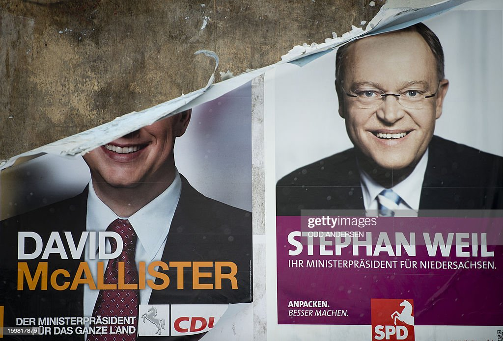 The picture of German politician Stephan Weil (SPD) is seen on an election poster next to a half torn one of the incumbent State Premier David McAllister the day after the elections in Hanover, northern Germany on January 21, 2013.Germany's centre-left opposition beat Chancellor Angela Merkel's ruling alliance Sunday in a cliffhanger state poll eight months ahead of a national election, estimates on public television showed. In one of the tightest German state races in recent memory, the Social Democrats together with the Greens eked out a one-seat lead in Lower Saxony in northwestern Germany, just ahead of the incumbent coalition of Merkel's Christian Democrats with the Free Democrats.
