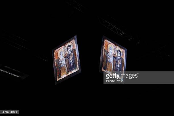 The picture of two icons are seen on two large screens at the Taizé prayer at the 35th German Protestant Church Congress The last full day of the...