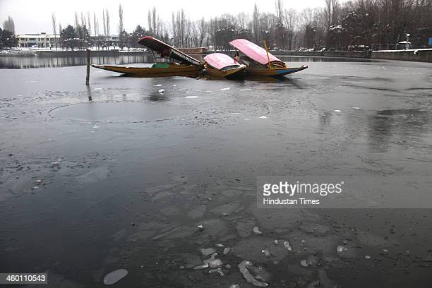 The picture shows a frozen part of a Dal Lake on January 2 2014 in Srinagar India A cold wave further tightened its grip in Jammu and Kashmir with...