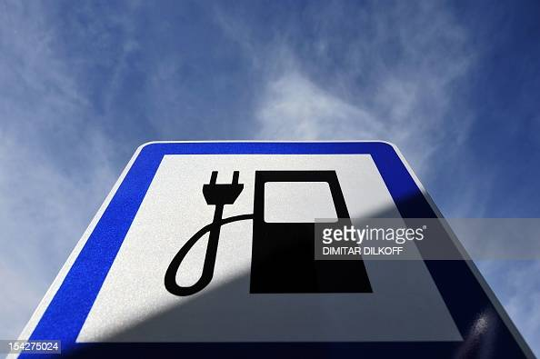 The picture shows a road sign next to a charging station for electric powered cars in Sofia on October 17 2012 Bulgaria's carpacked capital Sofia has...