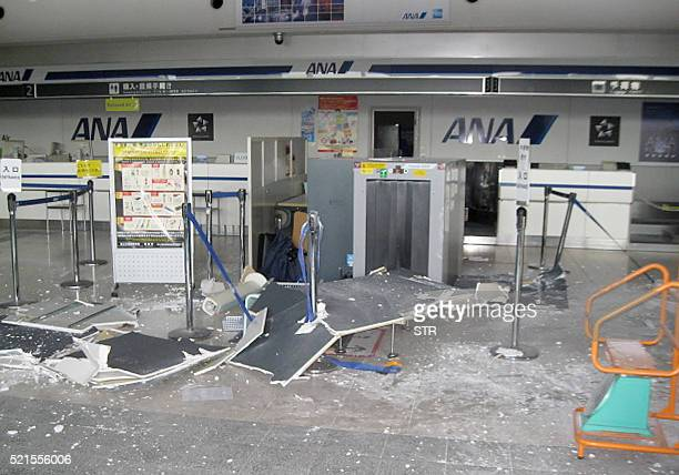 The picture shows debris on the floor inside the departure hall at Kumamoto Airport after an earthquake in Mashiki on April 16 2016 A powerful 70...