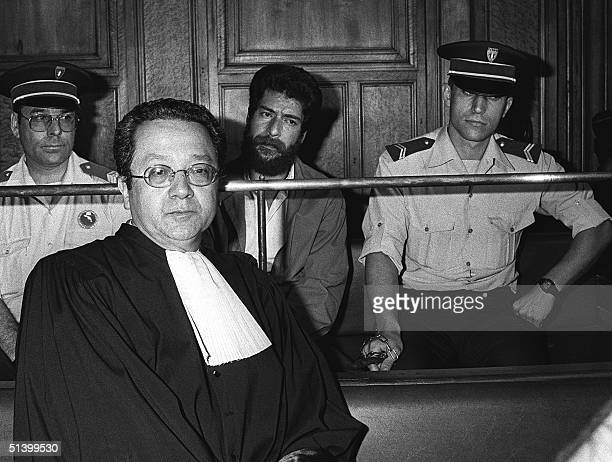 The picture shows Lebanese Georges Ibrahim Abdallah during his trial at the courthouse of Lyon 3 July 1986 with his lawyer Jacques VergFs Abdallah a...