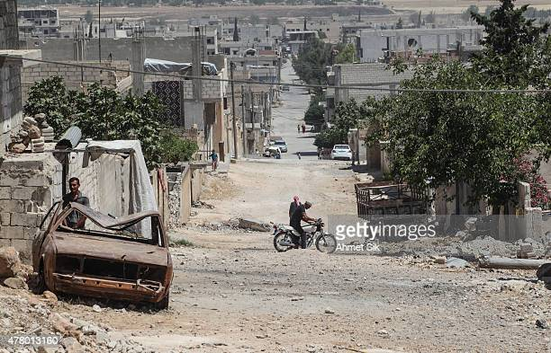 The picture shows the wreckage left by fighting on a street in the center of the Syrian town of Kobane also known as Ain alArab Syria June 20 2015...