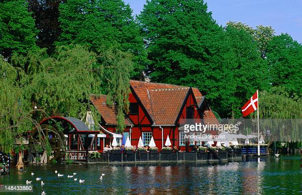 The picturesque Faergekroen restaurant on the shores of Tivoli lake offers traditional Danish fare in Tivoli Gardens.