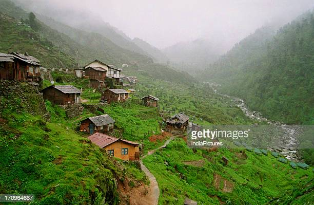 The picturesque of remote Kyongonsla village near NathuLa pass Sikkim engulfed in clouds and mist nestled in the lap of the mighty Himalayas India