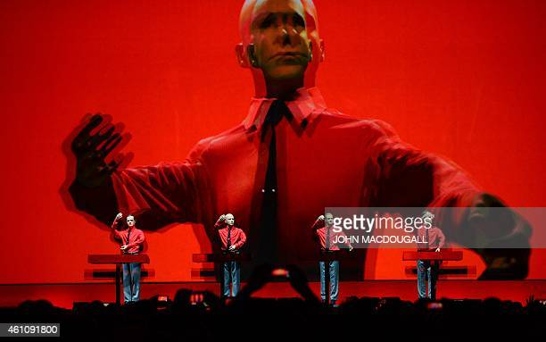 The piece 'Roboter' of the German band Kraftwerk is performed during a concert at the Neue Nationalgalerie museum in Berlin on January 6 2015 With...