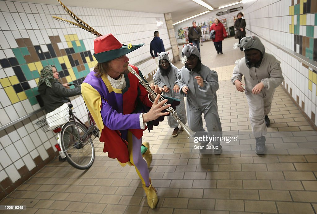 The Pied Piper of Hamelin, actually city tourism employee Michael Boyer, leads local children dressed as rats through a pedestrian underpass on November 19, 2012 in Hameln, Germany. The Pied Piper (in German: Der Rattenfaenger), is one of the many stories featured in the collection of fairy tales collected by the Grimm brothers, and the 200th anniversary of the first publication of the stories will take place this coming December 20th. Boyer, a U.S. citizen who has lived in Hameln for 15 years, and city children regularly perform a reenactment of the Pied Piper tale throughout the summer months. The Grimm brothers collected their stories from oral traditions in the region between Frankfurt and Bremen in the early 19th century, and the works include such global classics as Sleeping Beauty, Little Red Riding Hood, Rapunzel, Cinderella and Hansel and Gretel.