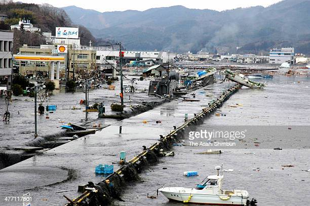 The pier appears after the backrush of the first wave of tsunami triggered by the magnitude 90 strong earthquake on March 11 2011 in Kesennuma Miyagi...