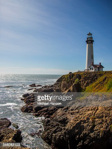 The Pigeon Point Lighthouse near Pescadero, California on a sunny day.