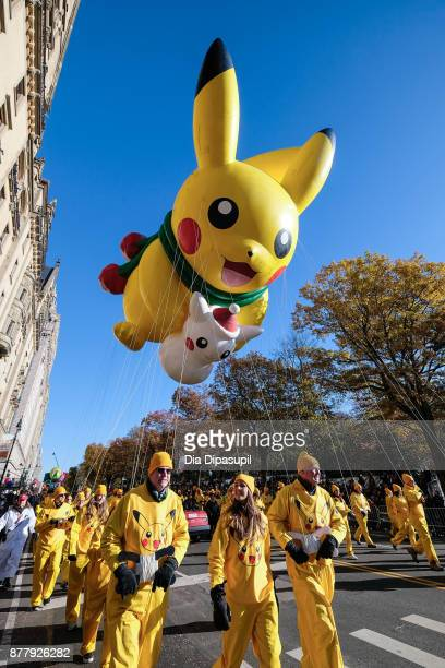 The Pikachu balloon floats down Central Park West during the 91st Annual Macy's Thanksgiving Day Parade on November 23 2017 in New York City
