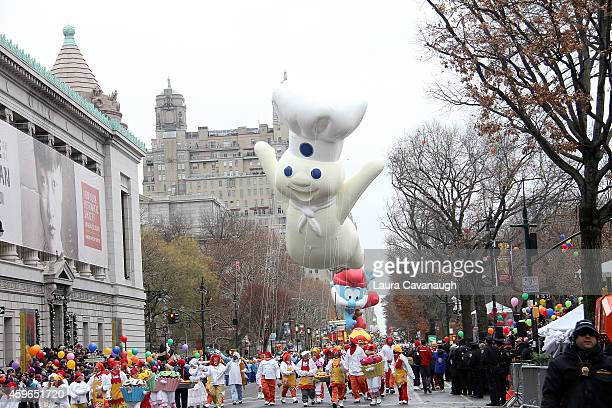 The Pillsbury Doughboy floats at the 88th Annual Macy's Thanksgiving Day Parade on November 27 2014 in New York City