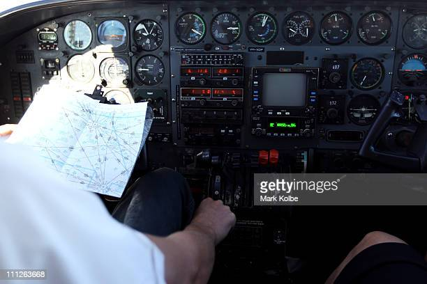 The pilot of a light airplane flies with a map for reference on March 28 2011 in Barcaldine Australia Queensland recently suffered a series of...