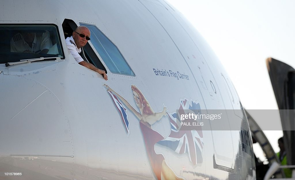 The pilot of the plane carrying England's national football team looks out of the window after landing at Johannesburg Airport in South Africa for the 2010 Football World Cup Finals on June 03, 2010. The team will transfer to their hotel and training base at the Bafokeng Sports Campus near Rustenburg, ahead of their opening game against USA on June 12.