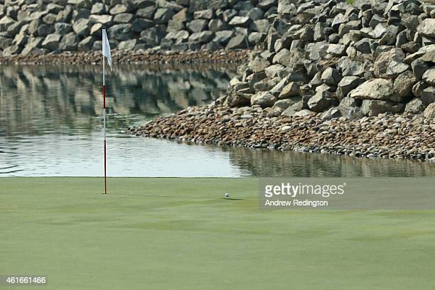 The pin flag and golf ball are seen on the seventh hole during the third round of the Abu Dhabi HSBC Golf Championship at the Abu Dhabi Golf Cub on...