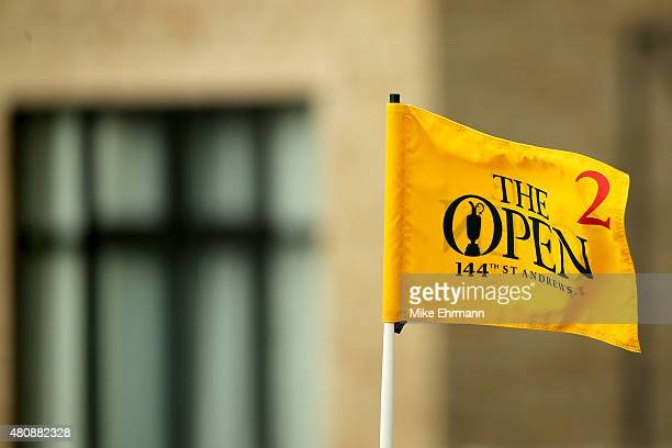 The pin flag on the 2nd green flutters in the breeze during the first round of the 144th Open Championship at The Old Course on July 16 2015 in St...