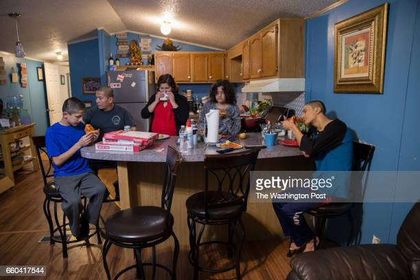 The Pineda family eats dinner together in their mobile homes kitchen area on February 7 in Lothian MD The family moved to the area when Ricardo...