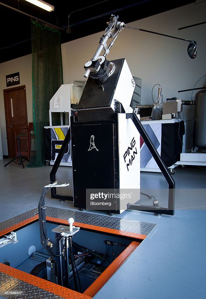 The 'Ping Man' robot tests a new G25 driver at the Ping Inc. production facility in Phoenix, Arizona, U.S., on Tuesday, Dec. 17, 2013. The U.S. Census Bureau is scheduled to release durable goods figures on Dec. 24, 2013. Photographer: Tim Rue/Bloomberg via Getty Images