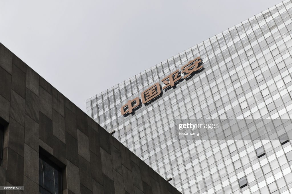 The PingAnInsurance Group Co. logo is displayed atop the Ping An International Financial Center (IFC) in Beijing, China, on Wednesday, Aug. 9 2017. Ping An Insurance Group is scheduled to release half year results on Aug. 17. Photographer: Qilai Shen/Bloomberg via Getty Images