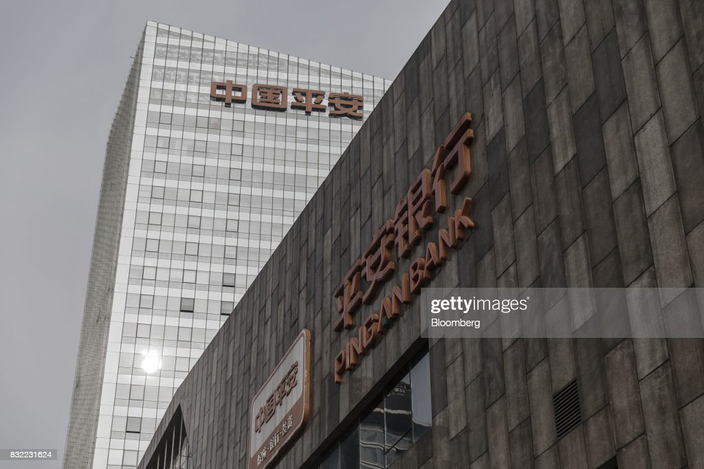 The PingAnInsurance Group Co. logo is displayed atop the Ping An International Financial Center (IFC) in Beijing, China, on Wednesday, 09 Aug. 2017. Ping An Insurance Group is scheduled to release half year results on Aug. 17. Photographer: Qilai Shen/Bloomberg via Getty Images