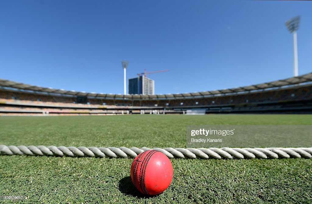 The pink coloured ball used in the first ever round of day and night Sheffield Shield matches is seen during day one of the Sheffield Shield match between Queensland and Tasmania at The Gabba on February 14, 2016 in Brisbane, Australia.