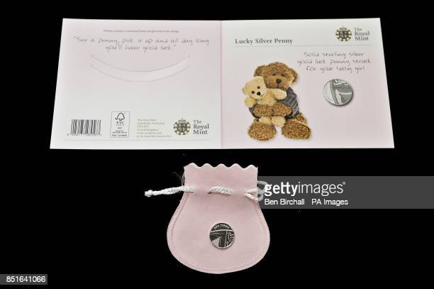 The pink for baby girls Silver Penny card produced by the Royal Mint to coincide with the brith of the royal baby