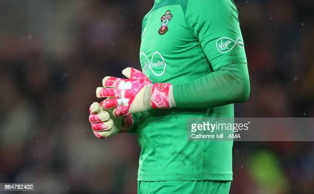The pink gloves of Fraser Forster of Southampton in support of Breast Cancer awareness during the Premier League match between Southampton and West...