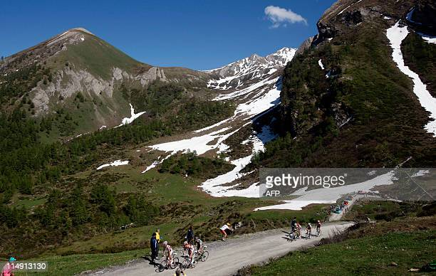 The pink jersey's pack climbs the Colle delle Finestre on stage 20 of the 94th Tour of Italy run from Verbania to Sestriere on May 28 2011 AFP PHOTO...