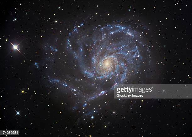 The Pinwheel Galaxy, also known as Messier 101 or NGC 5457, is a face-on spiral galaxy in the constellation Ursa Major.