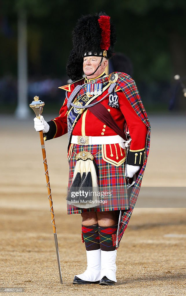 The Pipe Major of the Vancouver Police Pipe Band performs in the Household Division's Beating Retreat, watched by Prince William, Duke of Cambridge on Horse Guards Parade on June 12, 2014 in London, England.