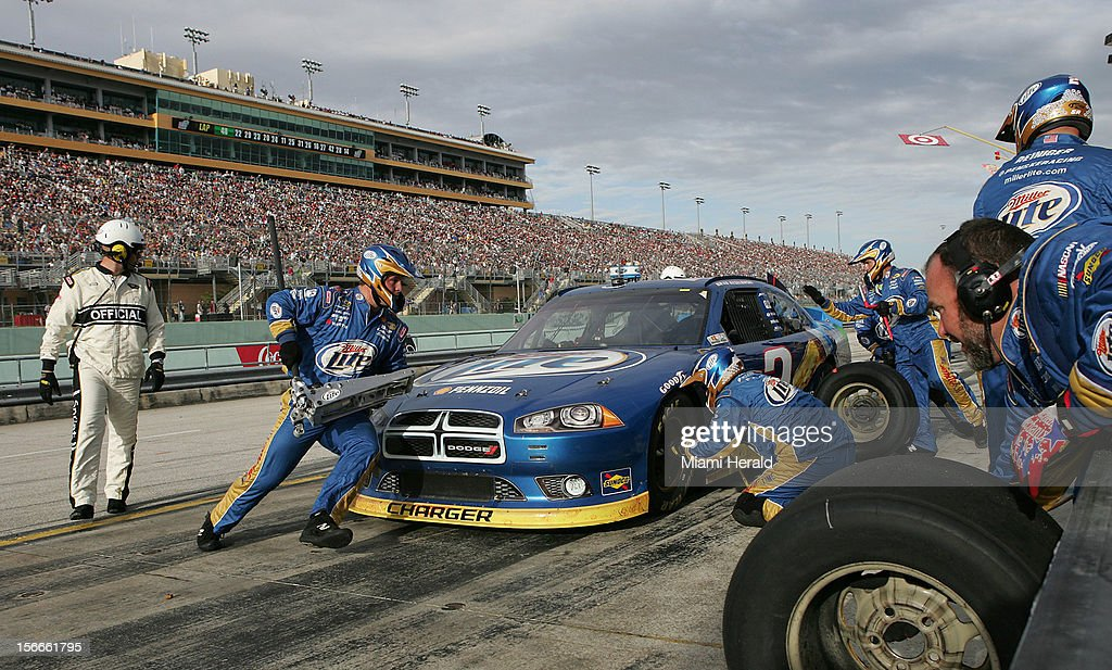 The pit crew services Brad Keselowski's car during the NASCAR Sprint Cup Series Ford EcoBoost 400 race Sunday, November 18, 2012, at Homestead-Miami Speedway in Homestead, Florida.