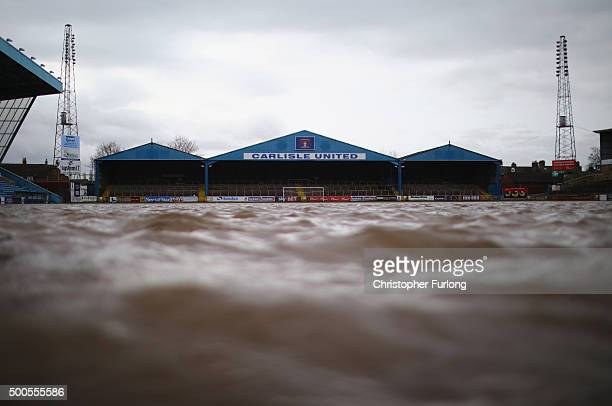 The pitch at Carlisle Football Club is still partly submerged after flooding created by Storm Desmond on December 9 2015 in Carlisle United Kingdom...