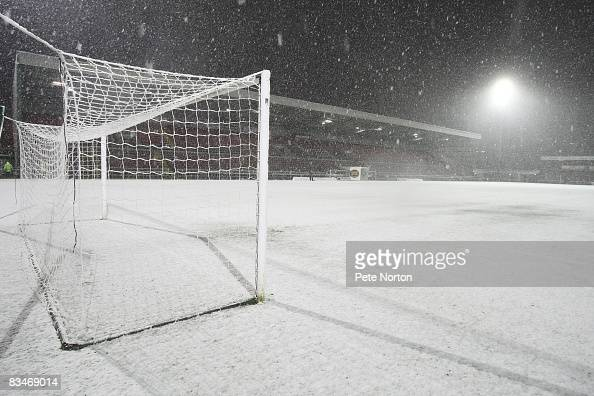 The pitch at Sixfields lies covered in snow prior to the postponement of the Coca Cola League One match between Northampton Town and Colchester...